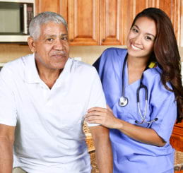 nurse and elder man smiling
