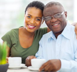 young woman and an elder man smiling