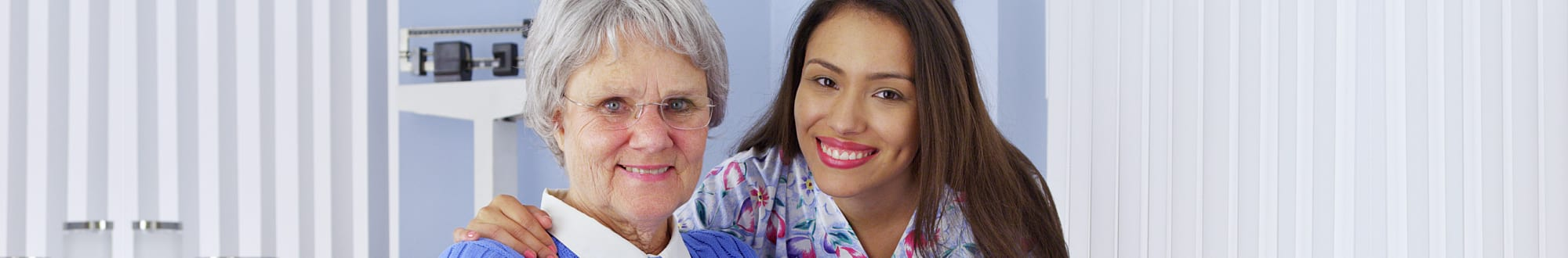 caregiver smiling with an elder woman